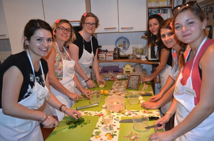 Students preparing food during a  private cooking class in Milan, Italy.