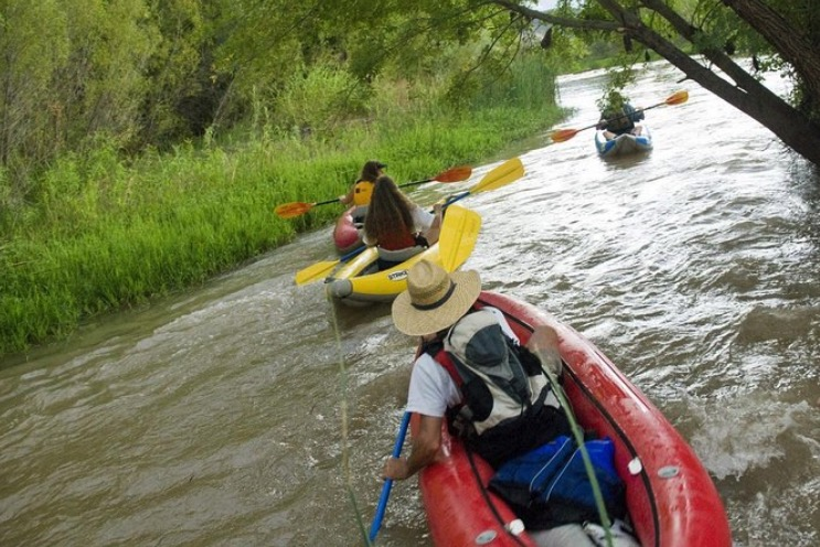 Kayakers on the Verde River in Arizona.