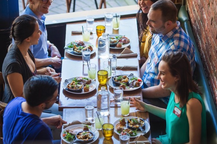 Diners enjoy food in the Gastown section of Vancouver.