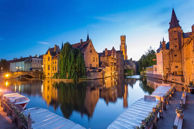 The canals in Bruges at sunset on a peaceful evening.