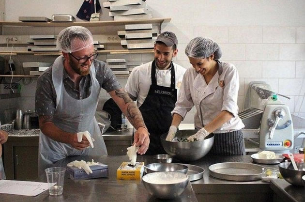 A chef teaches students Greek cooking in the Monastiraki neighborhood in Athens.