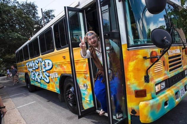 A host in Austin, Texas on a bus before a music and brews tour.