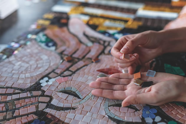 A student working on a mosaic in Barcelona, Spain.