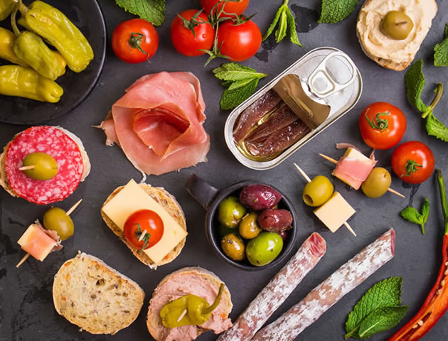 A neatly laid out platter of Spanish inspired tapas.