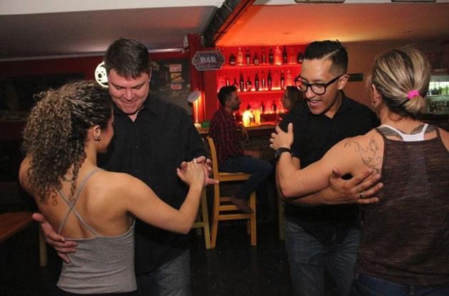 Two couples enjoy salsa dancing in Bogota, Columbia.