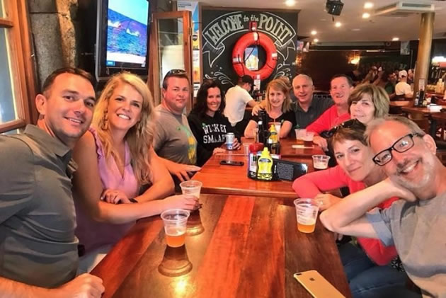 Tourists pose for a picture during a Boston pub crawl.