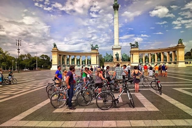 A bike tour stops to learn about Heroes Square in Budapest, Hungary.
