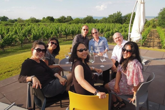 A group of travelers at a table waiting to begin a wine tasting in Budapest, Hungary.