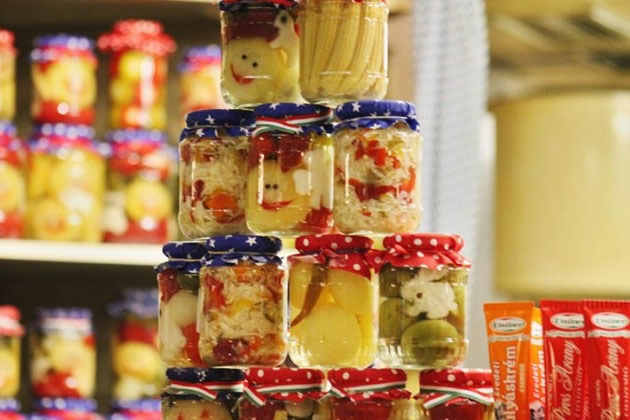 A tower of pickled food in jars.