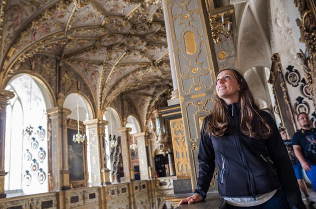 A women explores a castle in Roskilde, Denmark.
