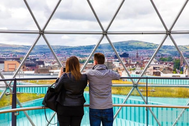 Two tourists over look a peaceful Belfast in Northern Ireland.