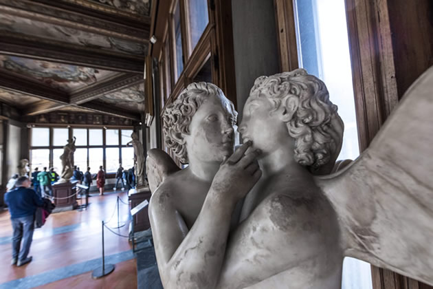 A statue of two angels in the Uffizi gallery in Florence, Italy.