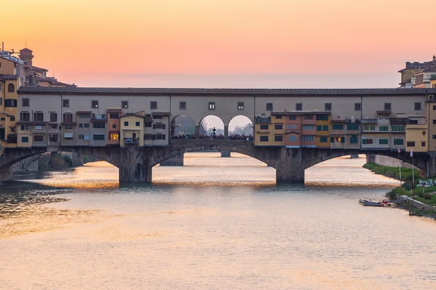 The Ponte Vecchio at sunset in Florence, Italy.