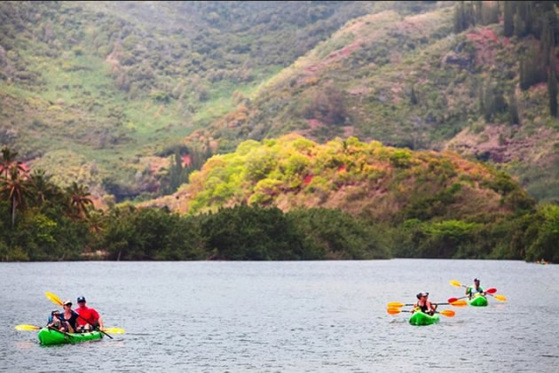 Kayakers on the Wailua River in Kauai, Hawaii.