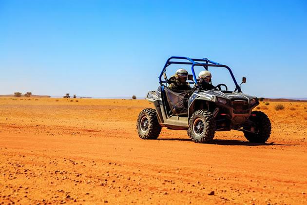 A RZR recreation vehicle travels on flat ground near Hidden Valley in Las Vegas, Nevada.