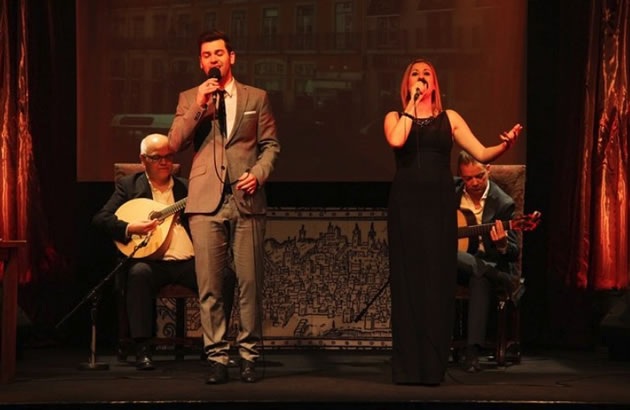 A man and a woman perform at a fado concert in Lisbon, Portugal.