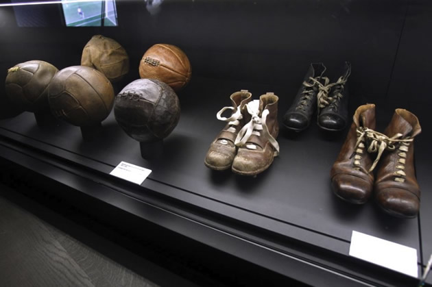 Old soccer boots and balls at Bernabeu Stadium in Madrid, Spain.