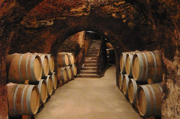 Wine casks at a winery in Madrid, Spain.