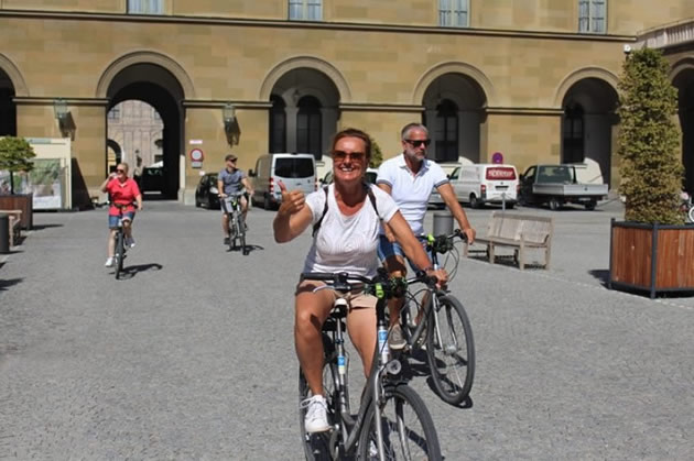 People riding bikes in Munich during a private city tour.