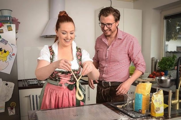 A chef teaches a student how to make pretzels in Munich.