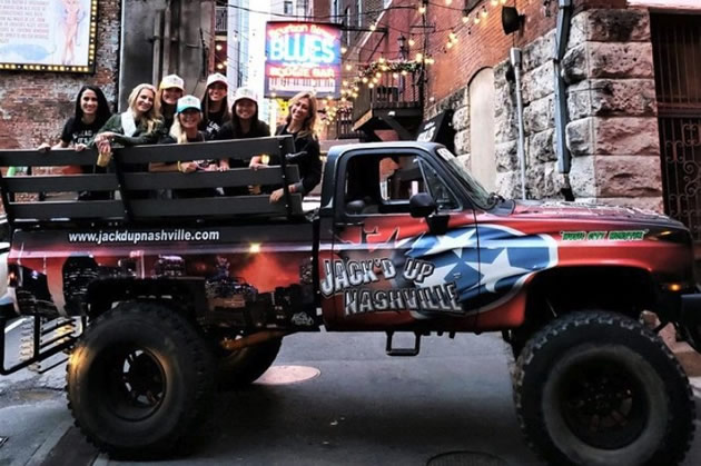Tourists enjoy a monster truck tour in Nashville, Tennessee.