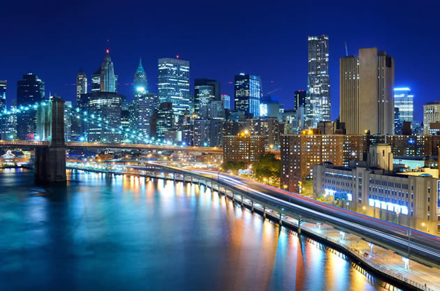The New York city skyline at nighttime.