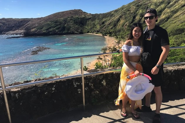 A couple pose on a bridge overlooking Hanauma Bay after a snorkeling excursion.