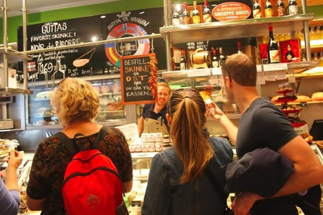 Tourists visit a food market in Oslo, Norway.