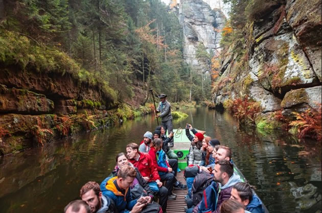 A group of tourists explore a gorge by vote in the Czech Republic.