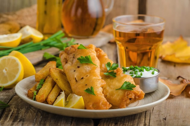 Fish and chips with a glass of beer in Reykjavik, Iceland.