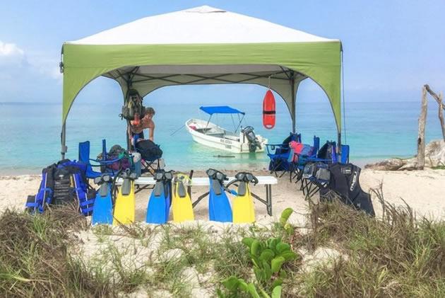 Snorkel equipment arranged on a table in Isla de Enmedio nature preserve near Veracruz, Mexico.