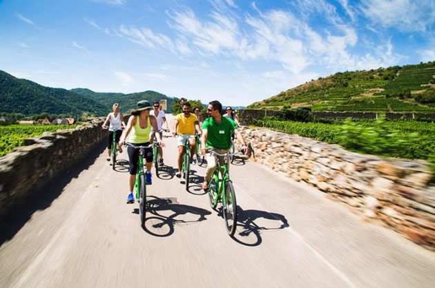 People on a bike tour in the Wachau Valley in Austria.