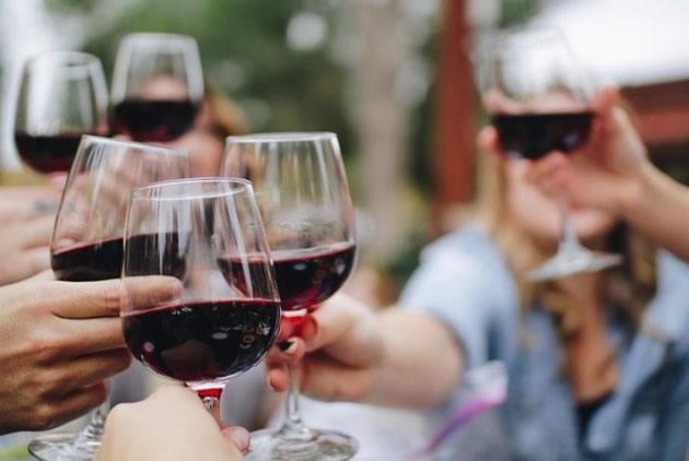 Tourists make a toast with red wine in Atlanta, Georgia.