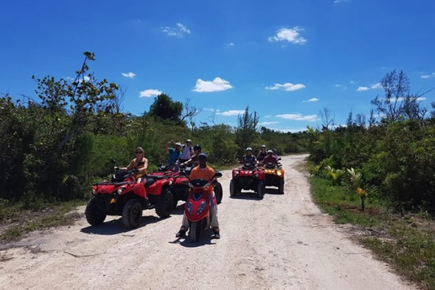 Tourists ride on ATV's in the Bahamas.