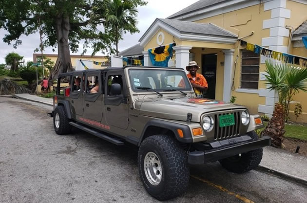 "A Jeep ""limo"" parked on a curb in the Bahamas."