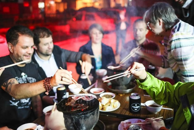 Tourists enjoy a hot pot in Beijing, China.