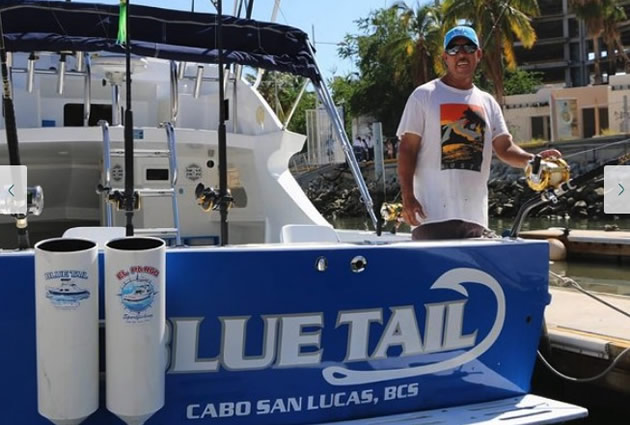 A fisherman welcomes guests on his boat in Cabo San Lucas.