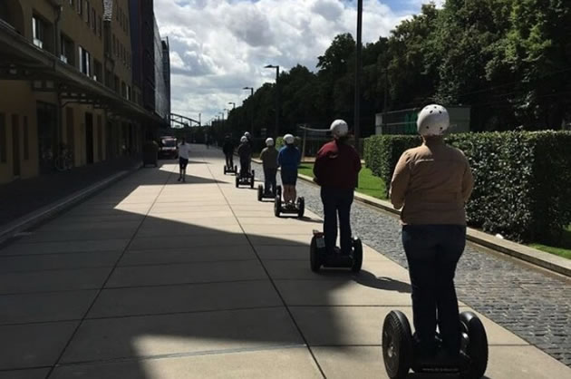Segway tourists ride along a greenbelt in Cologne.