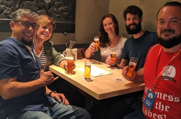 Tourists enjoy Cologne-style beers in a brewhouse.