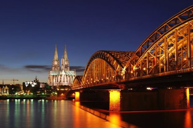 Cologne Cathedral pictured from the Rhine at sunset.