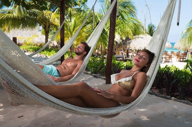 Vacationers in Cozumel, Mexico napping in hammocks.