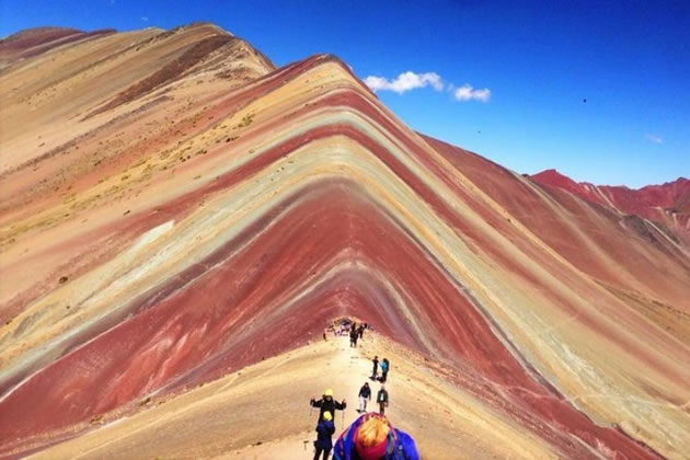 Hikers on the beautiful Rainbow Mountains in Peru.