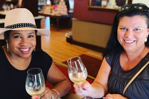 Tourists toast with a glass of wine in Dallas, Texas.