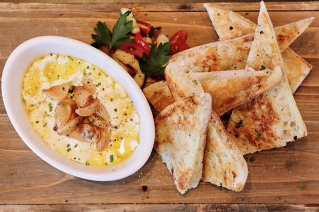 Toast points with fresh garlic dip in Dallas, Texas.