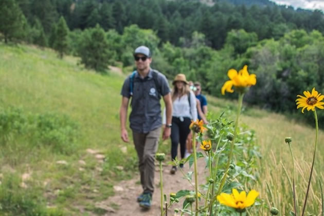 A tour guide leads hikers along a trail in Boulder, Colorado.