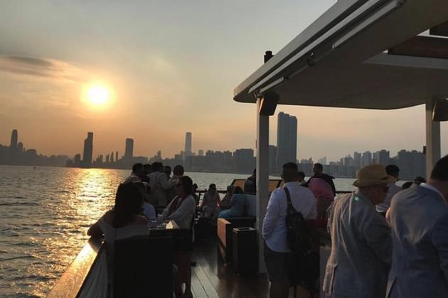 Hong Kong harbor seen aboard a luxury yacht at sunset.