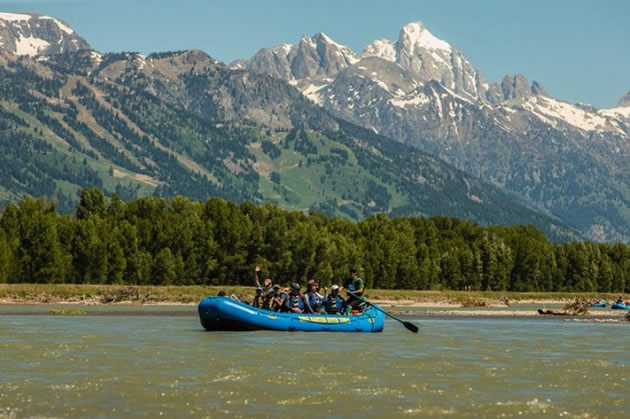 Tourists rafting on Snake River in Wyoming.
