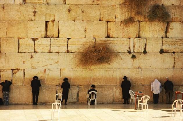 Devout Jews praying at the Wailing Wall.