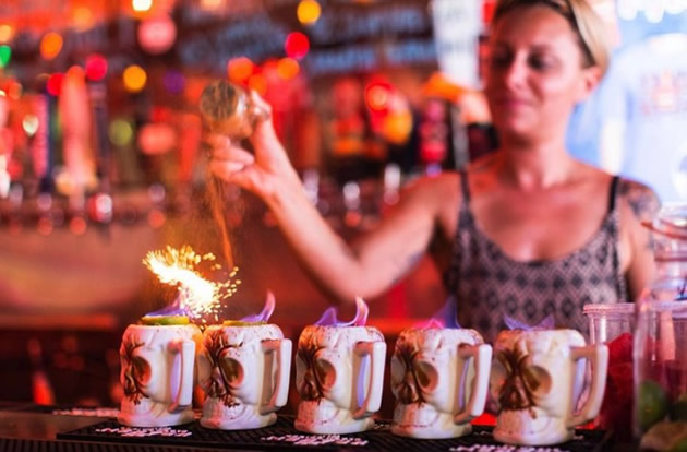 Key West Day Tours: Bartender prepares a flaming drink at famous Key West bar.