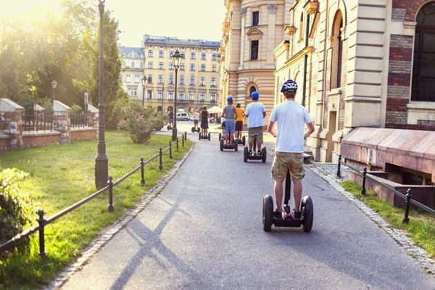 Tourists on Segways ride in Old Town Krakow.